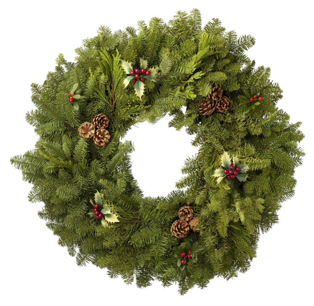 Green Christmas Wreath made from a variety of evergreens. Isolated on a White Background.